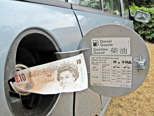 A ten pound note in an open fuel tank cap