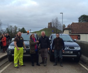 From left: Stuart Smith volunteer driver, Heather Venn Chair of FLAG, Cllr David Fothergill and Tim Holmes volunteer driver with the Mitsubishi L200s at Burrowbridge, Somerset