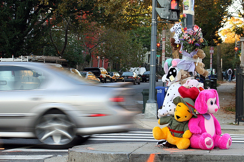 Road accident Memorial with colourful stuffed toys and a car