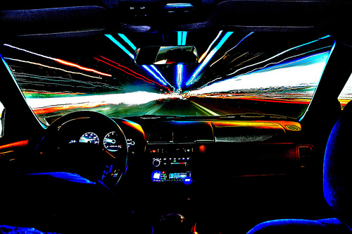 view through windscreen of lights in a tunnel