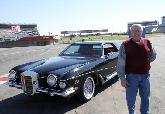 Automobile restorer Hollifield poses with Presley's 1973 Stutz Blackhawk III at Charlotte Motor Speedway