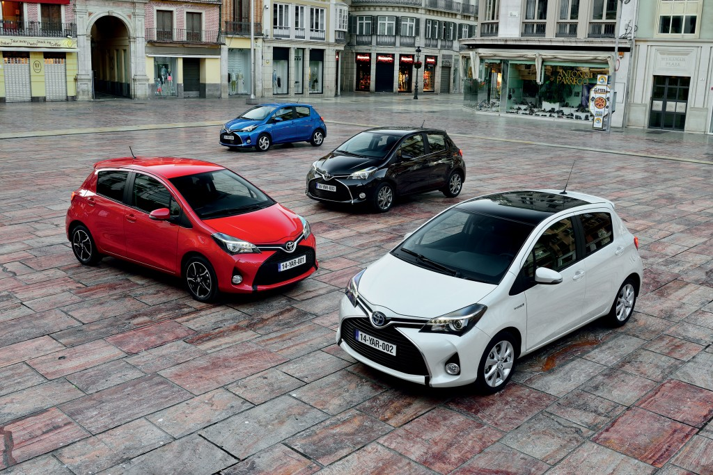 4 different coloured hatchbacks in a paved square