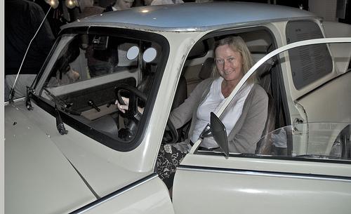 woman sitting in white car