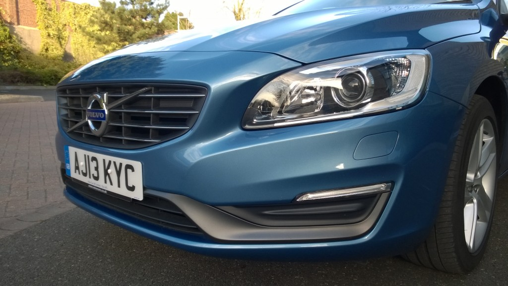 front end of silver blue executive car