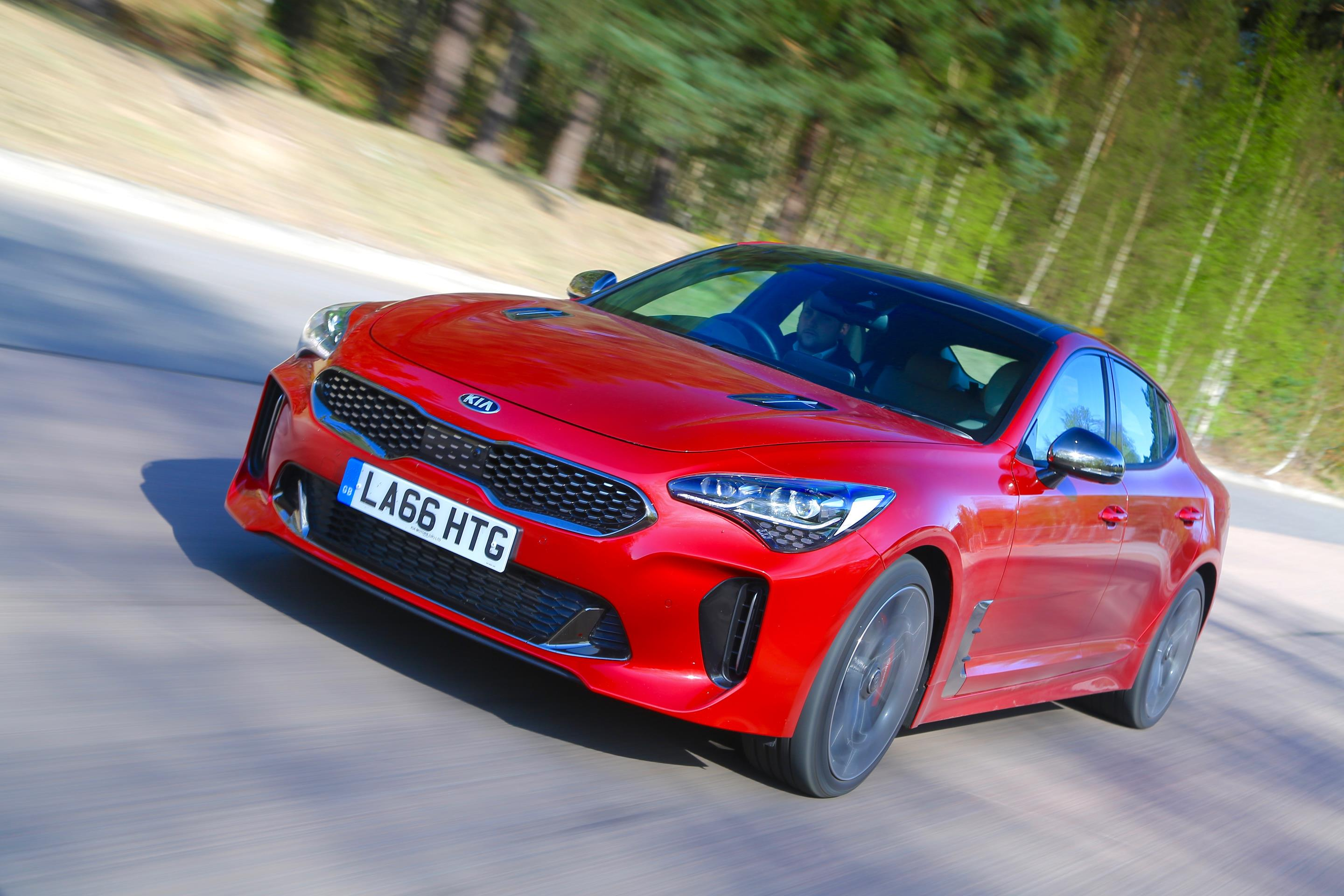 three front canada review kia car quarter gt motor track in motion news sports trend drive stinger en