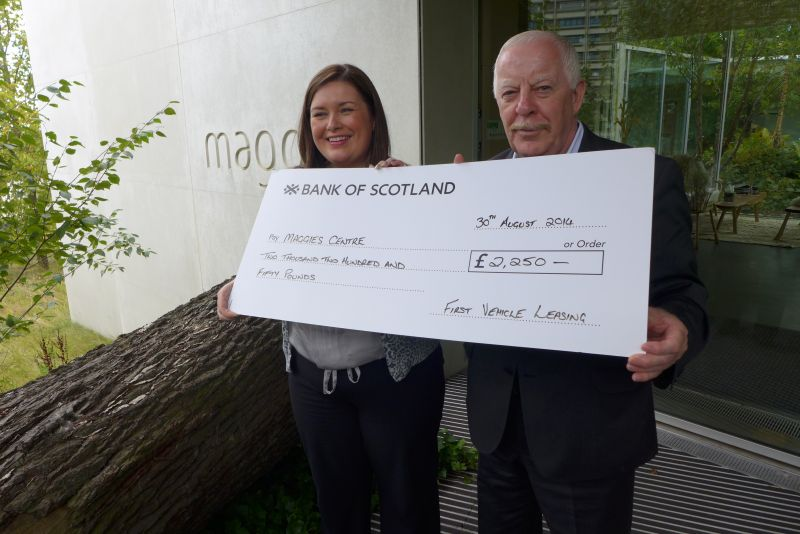 Dixie Deans of First Vehicle Leasing, former Celtic FC footballer,presents a £2,250 cheque to Tricia Imrie, centre fundraising manager, Maggie's Glasgow.